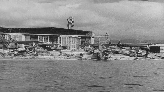 1941 Pearl Harbor: Destruction on shore.