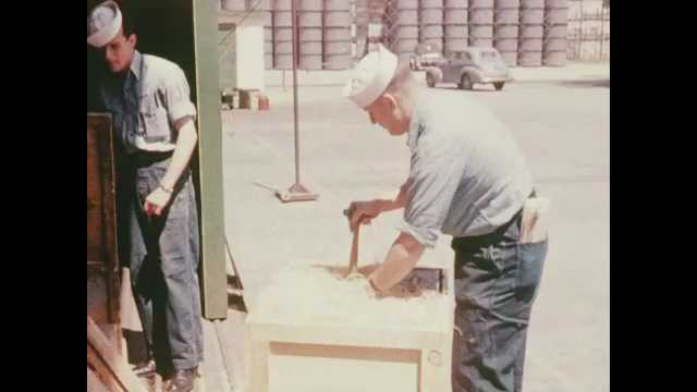 1940s San Diego: Sailors nailing boards on top of crate.