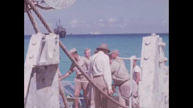 1940s San Diego: Men on small boat.  Men speak.  Damaged ship.