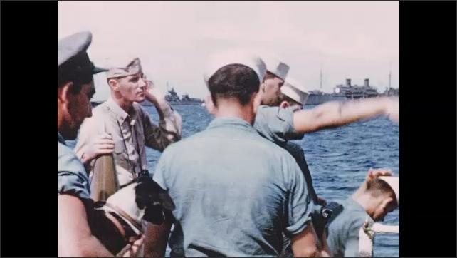 1940s Bikini Atoll: Ship, port, sailors form line, walk down steps, exit ship, salute. Man carries small dog under arm.