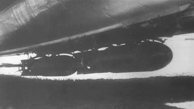 1940s Pacific Ocean: Bombs hang on underside of plane. Japanese officers consult map and talk at table.