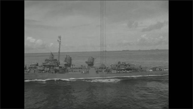 1940s: Destroyer boat sails on ocean.