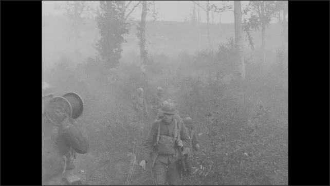 1910s: Soldiers march through field. Log fortress. Soldiers rest, smoke cigarettes.