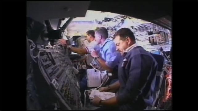 2000s: Computer animation of human brain. Astronauts onboard spacecraft, weightless. Computer screens. Astronauts floating onboard spacecraft.