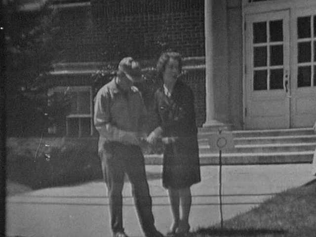 1960s: Teachers help students launch rockets in school yard. Kids watch rockets travel on string.
