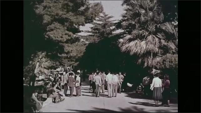 1960s: Shots of people walking through school campus.