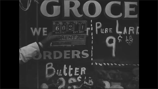 """1930s: Painted grocery store window """"Relief Orders Accepted"""" """"We Accept Relief Orders""""."""