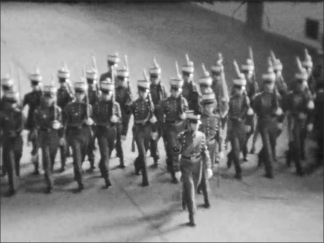 1930s: Platoon of Culver Military Academy cadets perform marching drills in gymnasium.