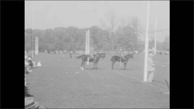 1930s: Officers on horseback observe troops gathered and marching on parade field at Culver Military Academy.
