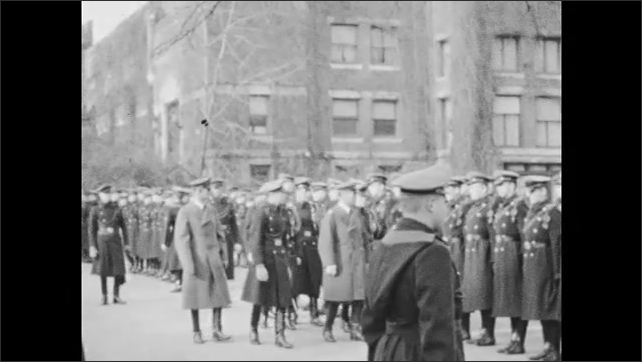1930s: Culver Military Academy cadets stand in formation before barracks for inspection.