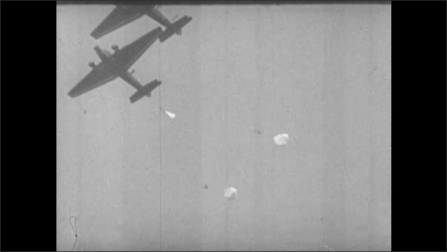 1930s: Slow motion, planes flying, paratroopers dropping from planes.