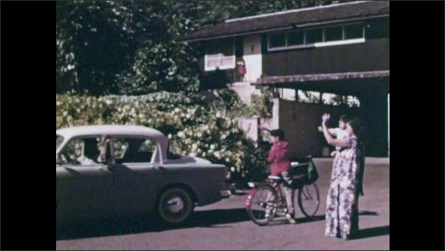 1960s: Boy rides bicycle up a driveway. Man waves from car and pats boy on head. Woman and girl wave. Boy sits on porch with a newspaper. Girl sits next to him. Boy with case waves to boy on porch.