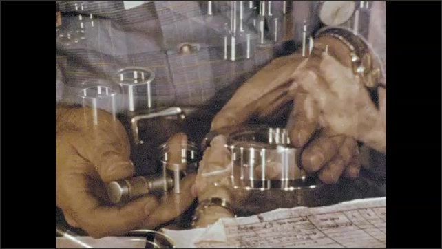 1970s: Man screws steel parts together, checks with tool. Man uses calipers with gauge to measure diameter.