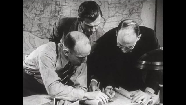 """1940s: People at work in office. Men at work in lab. Men study map. Title card. Ship with sign: """"Belgian Relief."""""""