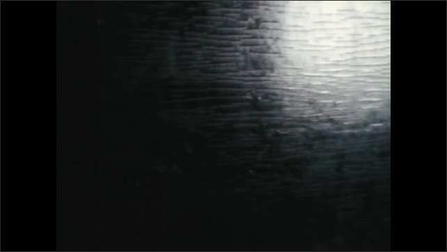 1970s: Soldiers line up on battlefield.  Man on horse. Cannon.