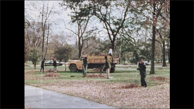 1970s: Person rakes leaves into basket in yard. People raking in park. Fuel truck hauls coal near building. Truck dumps coal from its hold.