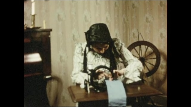 1960s: Woman uses sewing machine. Woman changes needle on sewing machine. Steamboat goes by on river.