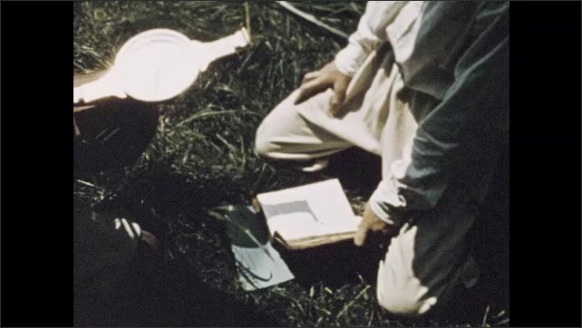 1950s: Plantation yard on river, Mount Vernon home in Virginia. Boys in colonial hats survey in field.
