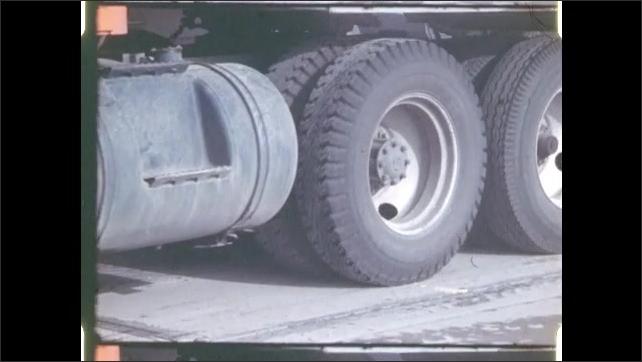 1970s: Truck in motion. Man on moon.
