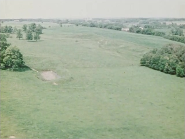 1970s: Aerial view from air of meadows, trees and farms on monarch migration route.