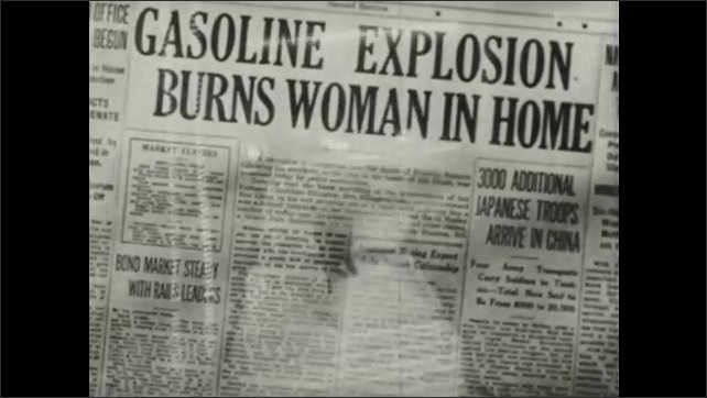 1940s: Printing press.  Newspaper headlines concerning deaths from household accidents.  Woman pours gasoline into bowl in kitchen.