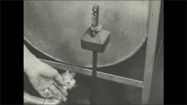 1940s: Fire marshall checks machine.