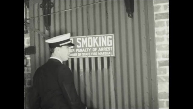 1940s: Man inspects dry cleaning facility.  Fire marshall turns switch and opens door.  Woman washes clothing in kitchen.