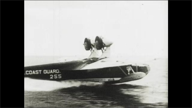 1940s: Ships at sea.  Airplanes fly.  Plane lands on water.  Soldiers jump from boats and run to beach.  Men.