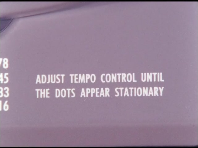 1960s: UNITED STATES: Adjust tempo control until the dots appear stationary. Lady adjusts knob. Tempo button.