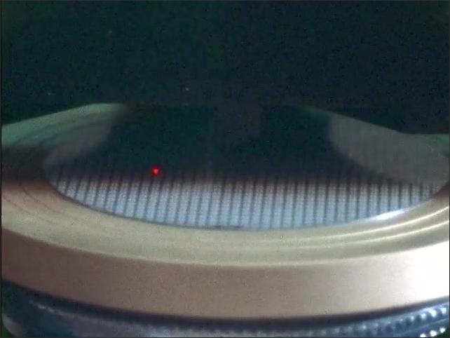1960s: UNITED STATES: laser light on wafer.