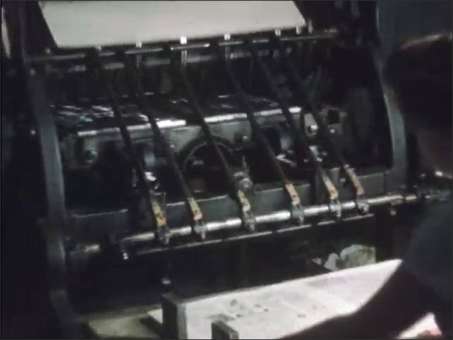 1950s: Paper moves through printing press.