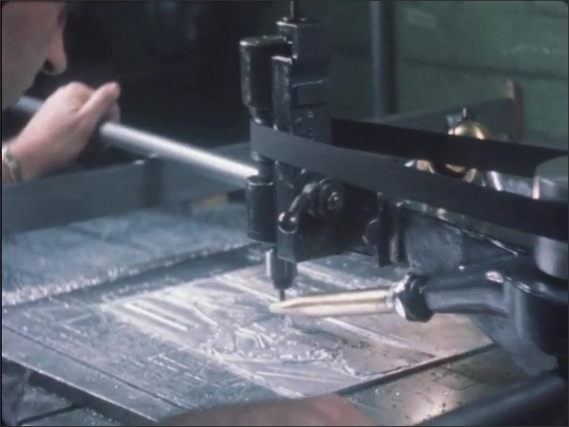 1950s: Man etches grooves into metal plate.