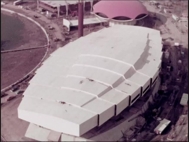 1960s: Aerial footage of World Fair under construction. Aerial footage of Bell Systems pavilion.