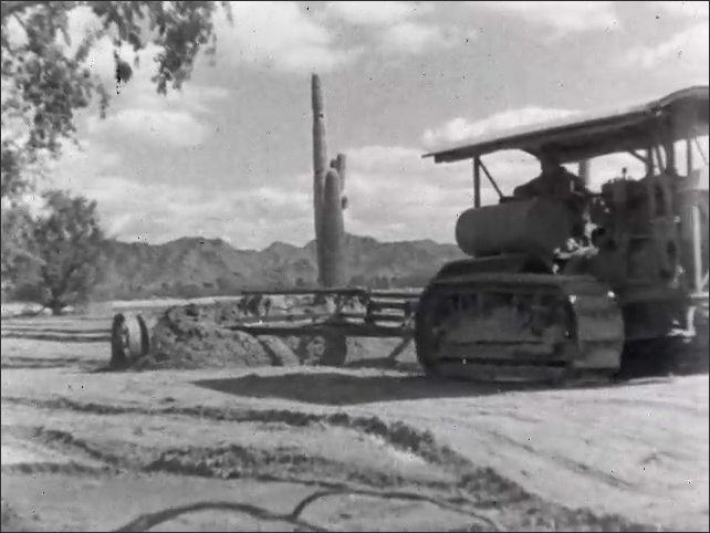 1940s: man bulldozing plants and weed, man driving tractor with large flat terracing tool
