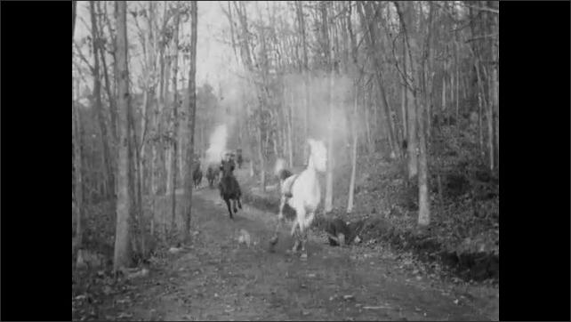 1900s: Forest.  Men pursue thieves on horseback.  Man falls off horse.  Man stops to drag fallen rider.