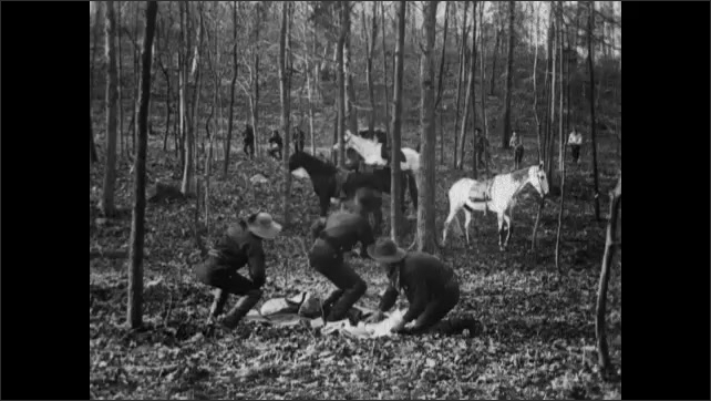 1900s: Forest.  Horses tied to trees.  Robbers hurry to bury loot.  Men shoot at thieves.  Men fall.  Men advance through woods.
