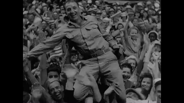 1940s: People in street celebrating end of World War II. Ticker tape, confetti