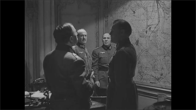 1940s: Nazi officers speak and look at map.