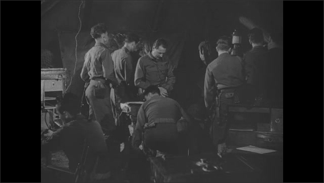 1940s: Soldiers plan and confer. Army truck in the woods. Interior truck with audio equipment.