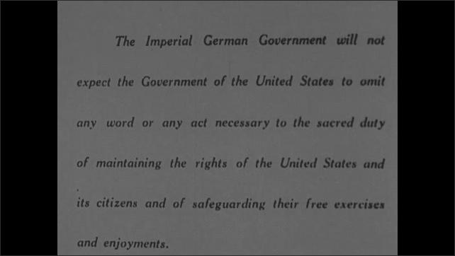 1910s: Airplane flies toward explosion.  Blimp.  Printed statement.  Woodrow Wilson addresses room of men.