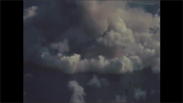 1940s Bikini Atoll: mushroom cloud from nuclear bomb experiment, clouds in sky