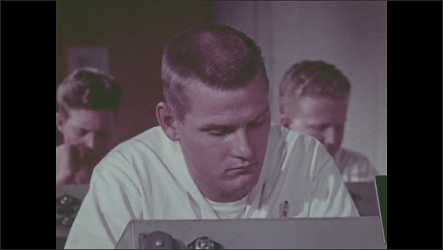 1960s: Men sit in classroom.  Ocean.  Liquid sprays from pipe.  Ships at sea.  Submarine surfaces.