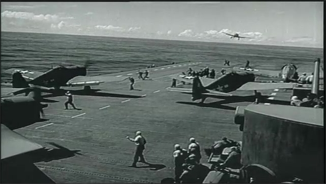 1950s: Bomber airplane in flight. Fighter plane takes off from aircraft carrier. People maintenance bomber.