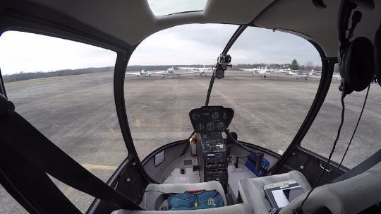 The cockpit of a helicopter prior to take off