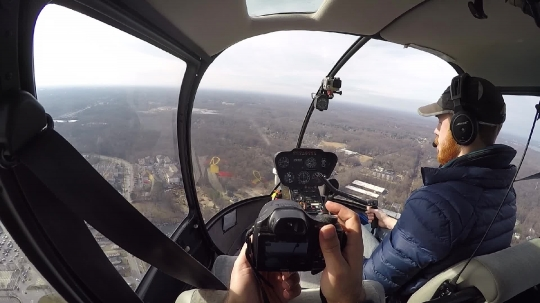 A tourist and a pilot during a helicopter ride